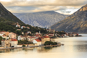 Town on the shores of the stunningly beautiful Bay of Kotor (Boka Kotorska) at sunset, UNESCO World Heritage Site, Montenegro, Europe