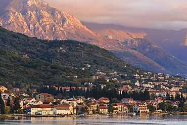Town at sunset on the stunningly beautiful Bay of Kotor (Boka Kotorska) at sunset, UNESCO World Heritage Site, Montenegro, Europe