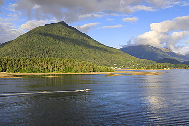 Forested mountains and small boat, from Sitka Sound, rare evening sun, summer, Sitka, Northern Panhandle, Southeast Alaska, United States of America, North America