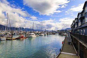 Small Boat Harbour, hotel, small boats and mountains, Seward, Resurrection Bay, Kenai Peninsula, Alaska, United States of America, North America