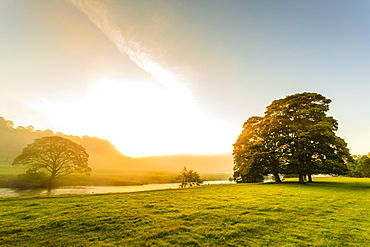 Autumn (fall) morning mist and the River Derwent, Chatsworth Park, home of the Duke of Devonshire, Chesterfield, Derbyshire, England, United Kingdom, Europe