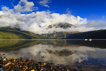 Low clouds and Teton Range reflected in Phelps Lake, Grand Teton National Park, Wyoming, United States of America, North America