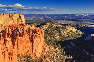 Rim cliffs and hoodoos lit by late afternoon sun with distant view in winter, Paria View, Bryce Canyon National Park, Utah, United States of America, North America