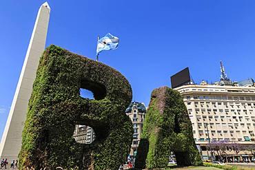 BA in topiary, Obelisco iconic monument and flag, Plaza de la Republica, Congreso and Tribunales, Buenos Aires, Argentina, South America