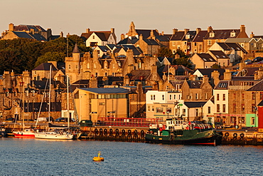 Lerwick, from the sea, waterfront sandstone buildings and golden early morning, Shetland Islands, Scotland, United Kingdom, Europe