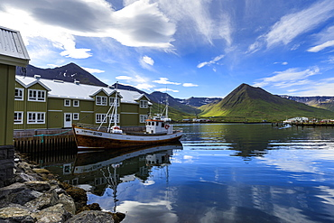 Fishing boat, hotel, mountain and fjord scenery, Siglufjordur, (Siglufjorour), stunning Summer weather, North Iceland, Europe, Europe