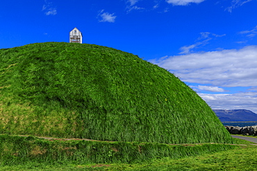 Thufa, green mound, blue sky, little house or fish drying shed in summer, Mount Esja, Old Harbour, Reykjavik, Iceland, Polar Regions