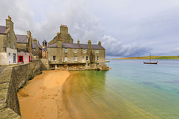 Weather front over Bain's Beach, smugglers cove, historic buildings, Central Lerwick, Shetland Isles, Scotland, United Kingdom