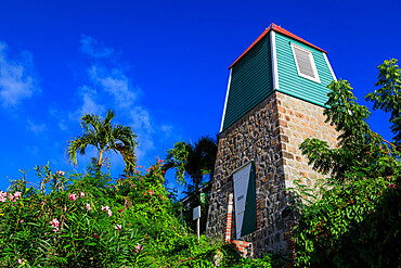 Swedish Bell Tower, palm trees and flowering shrubs, Gustavia, St. Barthelemy (St. Barts) (St. Barth), West Indies, Caribbean, Central America