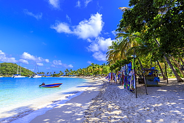 Saltwhistle Bay, white sand beach, turquoise sea, colourful boat, yachts, palm trees, Mayreau, Grenadines, St. Vincent and The Grenadines, Windward Islands, West Indies, Caribbean, Central America