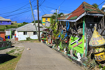 Quiet Caribbean, colourful buildings, sleeping dog, main street, village, Mayreau, Grenadines, St. Vincent and The Grenadines, Windward Islands, West Indies, Caribbean, Central America