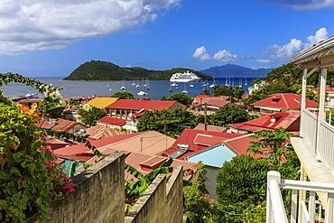 View to beautiful Les Saintes Bay across red roofs of town, Terre de Haut, Iles Des Saintes, Guadeloupe, Leeward Islands, West Indies, Caribbean, Central America