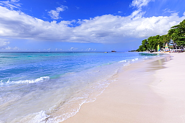Paynes Bay, small colourful sail boats pulled up on fine pale pink sand beach, beautiful West Coast, Barbados, Windward Islands, West Indies, Caribbean, Central America