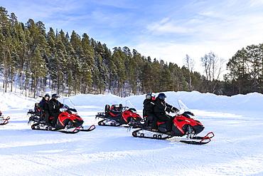 Snowmobile adventure, Alta Northern Lights tourists, winter snow and sun, Troms og Finnmark, Arctic Circle, North Norway, Scandinavia, Europe