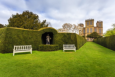 Yew hedge, seats and sculpture in spring at Hardwick Hall, near Chesterfield, Derbyshire, England, United Kingdom, Europe