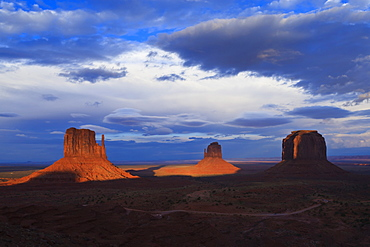 The Mittens at dusk cast long shadows, Monument Valley Navajo Tribal Park, Utah and Arizona border, United States of America, North America