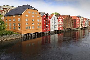 Colourful wooden warehouses on wharf beside the Nidelva River, Trondheim, Sor-Trondelag, Norway, Scandinavia, Europe