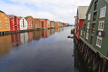 Colourful wooden warehouses on wharves beside the Nidelva River, Trondheim, Sor-Trondelag, Norway, Scandinavia, Europe