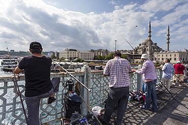 Fishermen, their rods and New Mosque, Galata Bridge, Golden Horn, Eminonu to Galata, Istanbul, Turkey, Europe