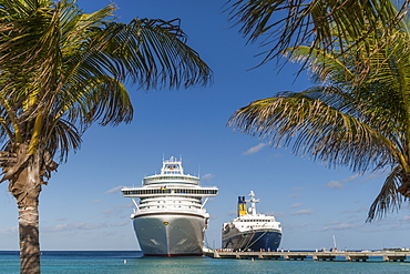 Cruise ships and disembarking passengers, seen through palm trees, Grand Turk, Turks and Caicos, West Indies, Caribbean, Central America