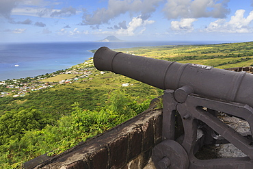 Cannon points towards the sea, with St. Eustatius in the distance, Brimstone Hill Fortress, UNESCO World Heritage Site, St. Kitts, St. Kitts and Nevis, West Indies, Caribbean, Central America