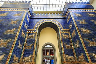 Visitors with audio guides pass through Ishtar Gate (Babylon), Pergamonmuseum (Pergamon Museum), Museum Island, Berlin, Germany, Europe