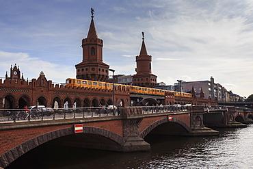 Busy Oberbaumbrucke, double-decker bridge linking two Berlin districts, Kreuzberg and Friedrichshain, over River Spree, Berlin, Germany, Europe