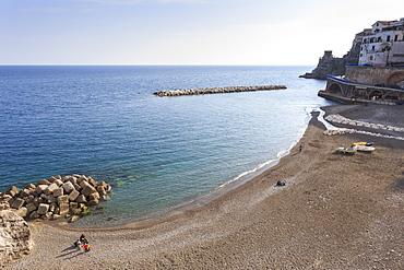 Elevated view of Atrani beach with family and fishing boats, near Amalfi, Costiera Amalfitana (Amalfi Coast), UNESCO World Heritage Site, Campania, Italy, Europe