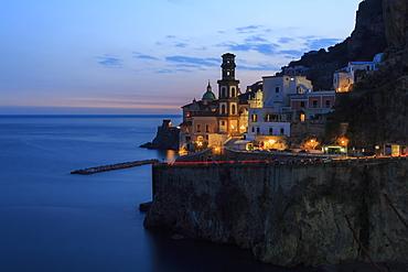 Amalfi coast road light trails from cars with Church of Santa Maria Maddalena at blue hour, dusk, Atrani, Costiera Amalfitana (Amalfi Coast), UNESCO World Heritage Site, Campania, Italy, Europe