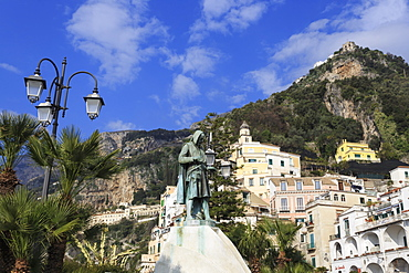 View from waterfront to statue, town of Amalfi and hillside, Costiera Amalfitana (Amalfi Coast), UNESCO World Heritage Site, Campania, Italy, Europe