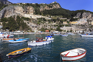Fishing boats in Amalfi harbour, cliffs and hills, Costiera Amalfitana (Amalfi Coast), UNESCO World Heritage Site, Campania, Italy, Europe