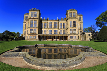 Hardwick Hall, near Chesterfield, reflected in pond under a clear blue sky, Derbyshire, England, United Kingdom, Europe