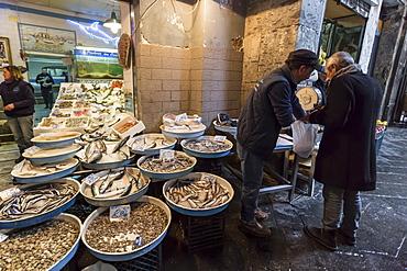 Man buys fish at fish shop, Historic Centre (Centro Storico), UNESCO World Heritage Site, Naples, Campania, Italy, Europe