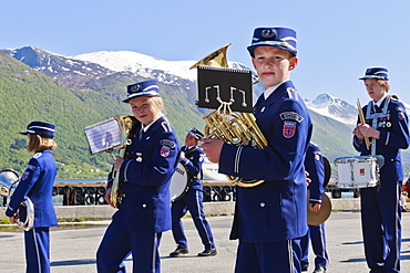 Fjordside youth brass band in a contest, snow capped mountains behind, Andalsnes, Romsdalsfjord, Norway, Scandinavia, Europe