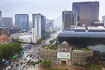 Elevated view over new City Hall, modern glass and steel building on Seoul Plaza, on a rainy summer day, Seoul, South Korea, Asia