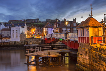 Old Swing Bridge over River Esk at dawn during the Christmas holidays, Whitby, North Yorkshire, England, United Kingdom, Europe