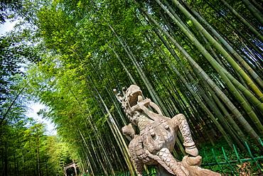 Stone Qi Ling statue, a mythical lion, at YunQi Bamboo Forest in Hangzhou, Zhejiang, China, Asia