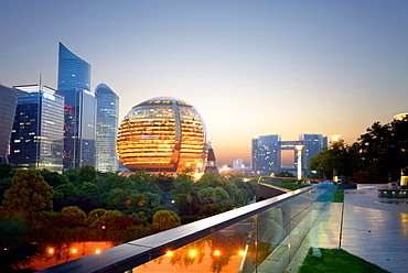 Jianggan district continues to fascinate with modern skyscrapers and sphere-shaped architecture of Hangzhou InterContinental, Hangzhou, Zhejiang, China, Asia