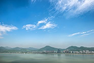Qiantang River, hills and high rises of Hangzhou, Zhejiang, China, Asia