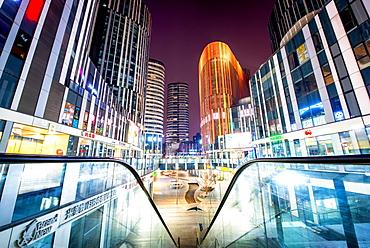 Escalator railings and illuminated futuristic architecture at Sanlitun SOHO, Beijing, China, Asia - 1171-244