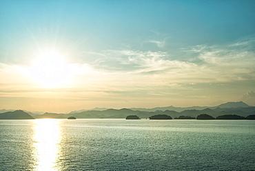 The sun about to set over the mountains surrounding Qiandao (Thousand Islands) Lake, Chunan, Zhejiang, China, Asia - 1171-251