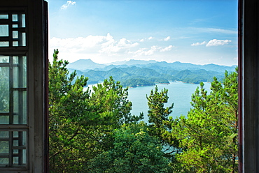 A view out the window on pine trees, the lake and mountain chains of Zhejiang province, China, Asia - 1171-254