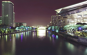 Illuminated architecture and reflections at night in Hangzhou City Center, Hangzhou, Zhejiang, China, Asia - 1171-263