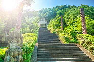 Steps flanked by stone pillars and Qi Ling lions leading up towards a stone gate, Zhejiang, China, Asia