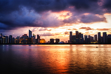 Dramatic clouds over Qianjiang River with skyline of Hangzhou's new business district, Hangzhou, Zhejiang, China, Asia - 1171-272