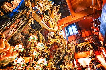 GuanYin Buddha at Yong Fu Temple with rich decorations in a wide angle perspective, Hangzhou, Zhejiang, China, Asia