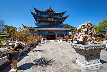Wanjuan Pavilion at Mufu Wood Mansion with lined up potted bonsai and rocks, Lijiang, Yunnan, China, Asia
