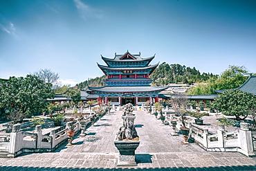 Wanjuan Pavilion, one of the main buildings at Mufu Wood Mansion with potted bonsai and rocks, Lijiang, Yunnan, China, Asia