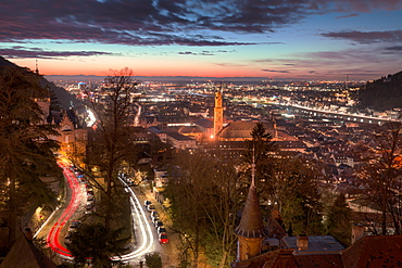 Elevated nightly view of Heidelberg Altstadt (Old Town) with spires and light trails, Heidelberg, Baden-Wurttemberg, Germany, Europe