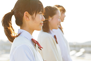 Portrait of Japanese schoolgirls in their uniforms looking away